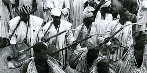 Traditional Gwari musicians playing large gourd-bodied kaburu plucked lutes and a goje fiddle, Nigeria..jpg
