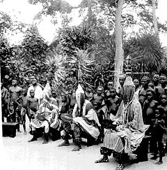 Ejukpe mask (nearest the camera) and other masks Ogonya Play, Ogume village, South Ika.jpg