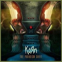 Обкладинка альбому «The Paradigm Shift» (Korn, 2013)