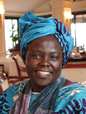 Wangari Maathai holding a trophy awarded to her by the Kenya National Commission on Human Rights