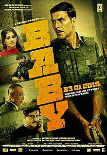 The poster features Akshay Kumar at left holding a pistol and taking cover behind a wall. At right appears title of the film, vertically.