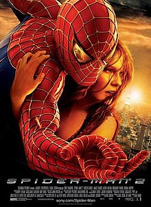 Against a New York City background, Spider-Man hugs Mary Jane Watson, with a reflection of Doctor Octopus in his eye as he shoots a web.