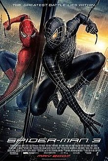 Spider-Man in the rain in his black suit looks at himself in a mirror wearing the original suit, with the film's slogan, title, release and credits below.