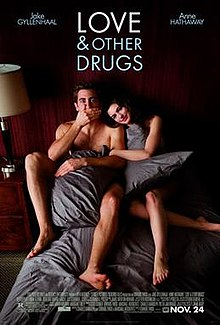 "Jamie (Jake Gyllenhaal) and Maggie (Anne Hathaway) are in torn blankets in bed, as information is below and ""Love & Other Drugs"" is at the top."
