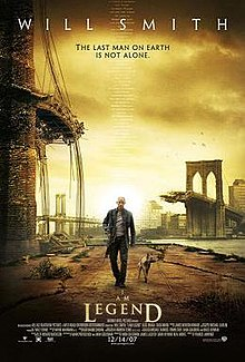 "A man wearing leather clothes and holding a rifle walks alongside a dog on an empty street. A destroyed bridge is seen in the background. Atop the image is ""Will Smith"" and the tagline ""The last man on Earth is not alone"". Below are the film's title and credits."