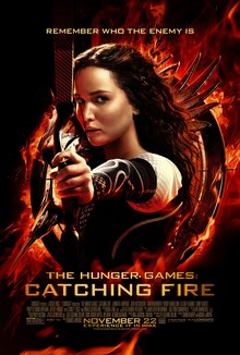 A girl holding a bow, pulling back an arrow, in a fiery circle against a black background.