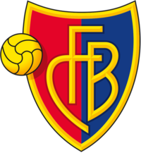 "FC Basel crest of a shield, the left half red and the right half blue. The shield is outlined with gold and in the centre in gold letters it reads ""FCB"". On the left side of the logo is a gold football."