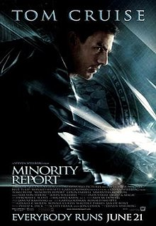 "A man wearing a leather jacket stands in a running pose. A flag with the PreCrime insignia stands in the background. The image has a blue tint. Tom Cruise's name stands atop the poster, and the title, credits, and tagline ""Everybody Runs June 21"" are on the bottom."