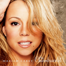 "A close-up of a blond woman, whose mouth is a little open and her right hand is partially visible on top of her head. At the bottom of the image, the words ""MARIAH CAREY"" and ""Charmbracelet"" are written in white letters."