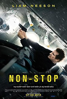 A man falling back along an airplane, firing a gun.