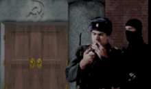 A building with two wooden doors and a hammer & sickle engraved above them, a Soviet soldier played by Frank Klepacki lighting a cigarette, a man dressed in black moving up behind him