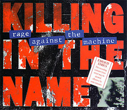 "Large red block capitals on black background reads ""killing in the name."""