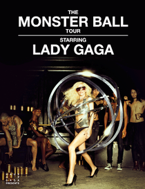 A female blond woman stands in a silvery metallic leotard. Her left foot is put forward and she wears black heels and sunglasses. Around her, she wears a number of concentric metallic rings which encircles her. Behind her, a number of drunk men are visible, some standing and some sitting. Above the woman the words 'The Monster Ball Tour' is written in white font. Beneath it, the words 'Starring LADY GAGA' are written in white on black.