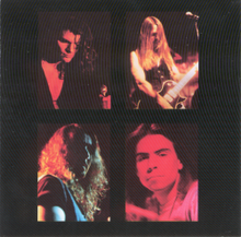 A black image with four portraits of members of the band I AM, the singer holding a microphone, the guitarist leaning back, the bassist obscuring his face with shadow, Frank Klepacki gazing into the camera
