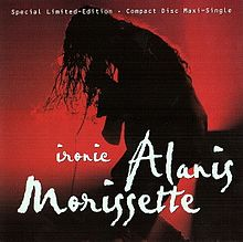 "A woman in silhouette singing and bending down with the microphone. The silhouette background is filled with red lights and shadows, and the words ""Alanis"", ""Morissette"" and ""Ironic"" are written in white cursive letters at the bottom half of the image."
