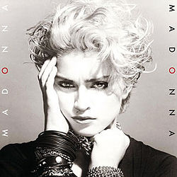 "Sepia image of a young blond female. Her short cropped hair is unkempt on her head. The right hand is placed on her right cheek and with the left hand, she holds on to a number of chains wound on her neck. She wears a number of black bangles on her hands. On both sides of the image, the word ""MADONNA"" is written, once in black and once in white. In both cases, the ""O"" is painted red."