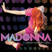 "Back of a woman with fiery red hair and wearing a pink leotard. Her legs are stretched apart and she wears pink shoes with heels. Her left hand is stretched right out and she tilts her head back while supporting herself with her right hand. The backdrop reveals small colored circles like a disco ball. On the image, the word ""Madonna"" is written in capital pink-and-white stripes. Beneath it, ""Confessions on a Dance Floor"" is written in white flowing script."