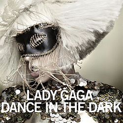 "Face of a blond woman, whose platinum blond hair is shaped in a bob cut. She wears a shiny dark colored dress and has a black mask with strings around it on her eyes. The woman tilts her head to the right. Beneath her chin, the words ""Lady Gaga"" and ""Dance in the Dark"" are written in white bold font."