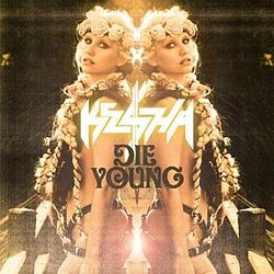 "A Caucasian female with blond braids and a floral diadem. She is sparsely clothed in a suit of leather strips with much skin expose. Back facing a mirror, her reflection is symmetrically depicted with the words ""Kesha"" and ""Die Young"" appearing in the center."