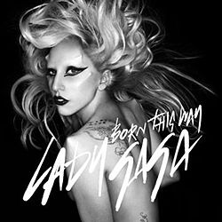"Greyscale image of a nude woman, with unkempt blond hair. She has thick black eyeliner and lipstick. There are unnatural bumps coming from the woman's face and shoulders. On the image capital script it reads ""Born This Way"". Underneath the same; with larger font saying ""Lady Gaga""."