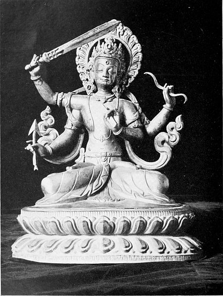 Black and white photograph of a statuette of Manjusri.