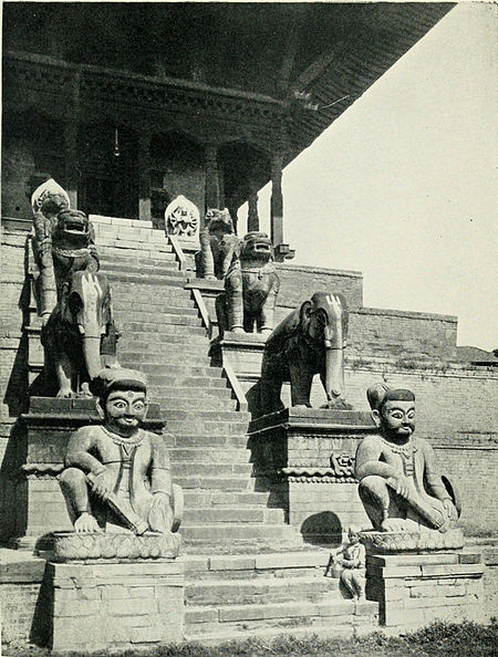Black and white photograph of the steps of the Nyatpola Deval, or the Temple of the Five Stages, at Bhatgaon.