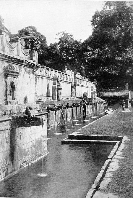 Black and white photograph of fountains in the garden at Bajali.
