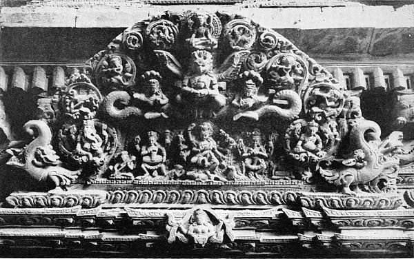Black and white photograph of wood-carving over doorway at Katmandu.